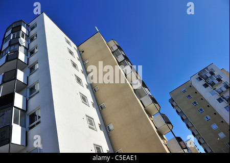 Low angle view of high rise buildings against clear blue sky - Stock Photo