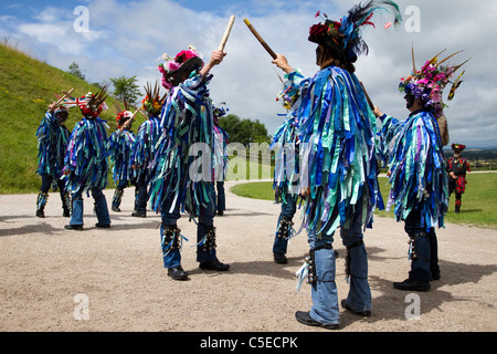 Exmoor Border Mixed Morris Dancers, black-faced, wearing long flowing torn old rags, clothing made from wide bolts - Stock Photo