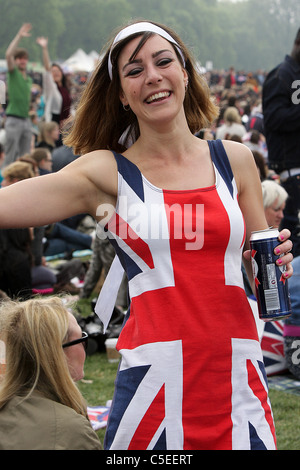 THE ROYAL WEDDING DAY 2011, this young woman dressed in the Union Jack enjoys the day of the wedding in Hyde Park, - Stock Photo