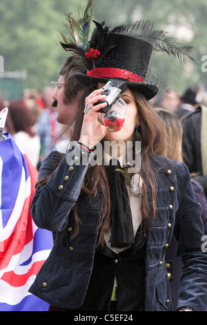 THE ROYAL WEDDING DAY 20011, young female reveller enjoys a quick drink whilst enjoying the happy atmosphere in - Stock Photo