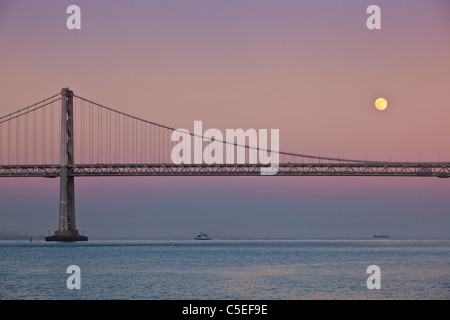 San Francisco Full moon rising over the Oakland Bay Bridge sunset California, United States of America, USA - Stock Photo