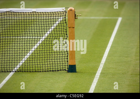 Post and net on Centre Court during the 2011 Wimbledon Tennis Championships  - Stock Photo