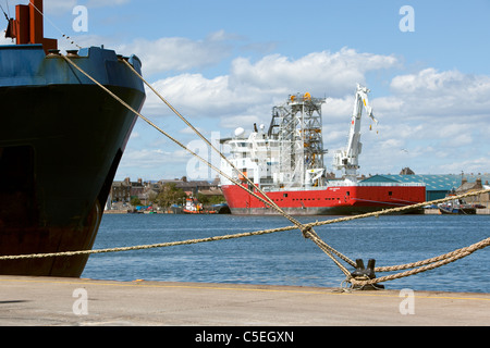 Ropes securing ships to quayside at Montrose Harbour Scotland - Stock Photo