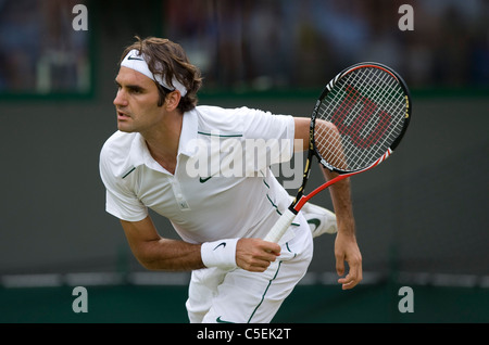 Roger Federer (SUI) in action during the 2011 Wimbledon Tennis Championships - Stock Photo