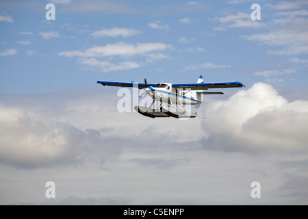 A de Havilland Canada DHC-3 Otter float plane or airplane flies over Puget Sound in the state of Washington - Stock Photo