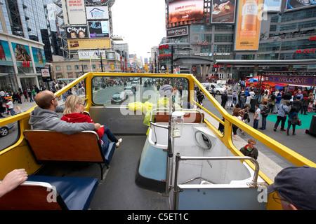 open top guided bus city tour top deck downtown yonge dundas square toronto ontario canada - Stock Photo