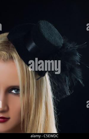 Beautiful woman wearing a black hat - Stock Photo