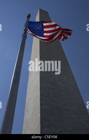 American Flag Flying in front of the Washington Monument, Washington DC, USA - Stock Photo