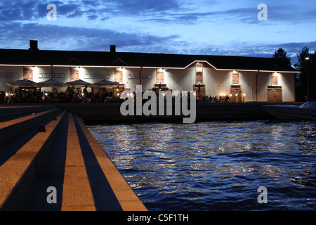 Kuopio harbor by night. Bar terrace on a light summer night - Stock Photo