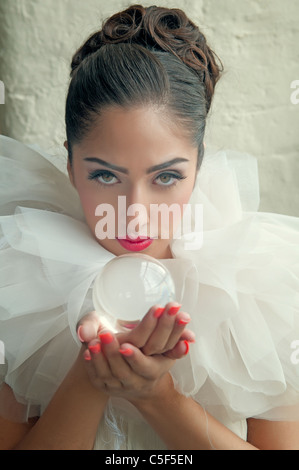 Woman holding a crystal ball - Stock Photo