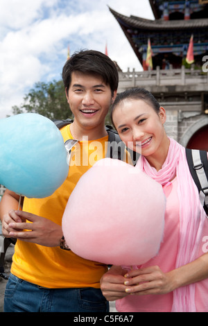 Young Couple with Cotton Candy, Dali - Stock Photo