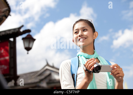 Young Woman Exploring Dali with Video Camera Stock Photo