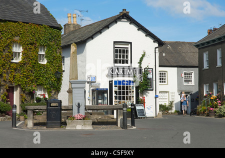 Man carrying little girl on his shoulders, in village of Cartmel, Cumbria, England UK - Stock Photo