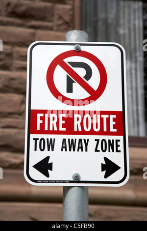 no parking fire route tow away zone sign in downtown toronto ontario canada - Stock Photo
