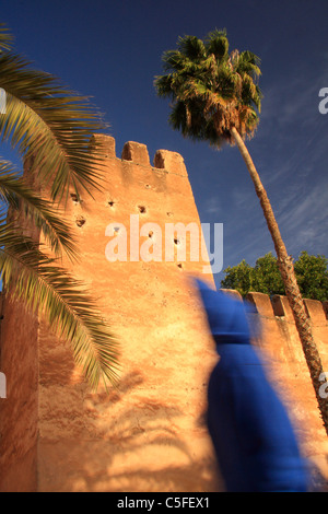 Person earing traditional Moroccan jellabah walks by Taroudant's town walls, Taroudant, Souss Valley, Morocco, N. - Stock Photo