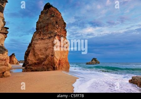 Portugal, Algarve: Rock at beach Praia da Rocha in Portimao - Stock Photo