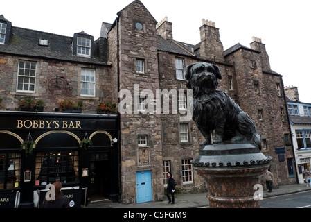 Statue of famous Scottie dog Bobby and Bobby's Bar Edinburgh Greyfriars Scotland UK - Stock Photo