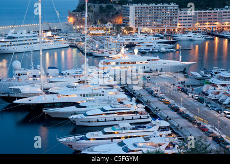 Luxury yachts in the main harbour at dusk, Monte Carlo, Monaco - Stock Photo