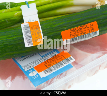 Reduced price labels on food items - Stock Photo