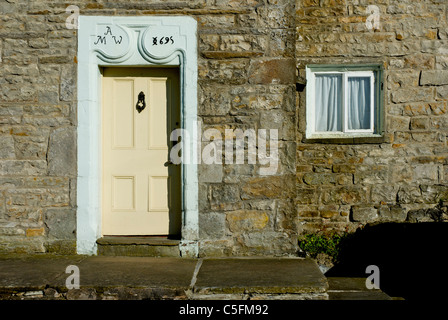 Door of house in village of Gayle, near Hawes, Wensleydale, Yorkshire Dales National Park, England UK - Stock Photo