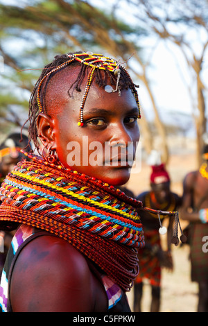 Turkana people live in Kenyas' northwest district, a dry hot region. They are noted for raising camels and weaving - Stock Photo
