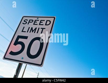 Speed limit signs along Pecos Road near Phoenix, AZ. - Stock Photo