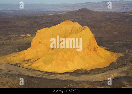 A crumbling extinct volcano, which is known as Aruba Rock - Stock Photo
