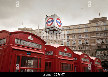 Red telephone boxes outside Charing Cross station, London UK - Stock Photo