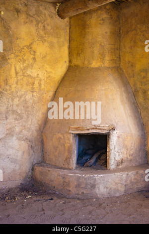 Adobe Cantina building fireplace on movie set built for the movie 'Streets of Laredo' in Texas - Stock Photo