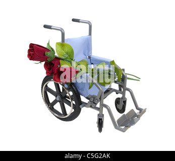 Road to Recovery shown by red rosed laid across a wheelchair used for assistance in personal transportation - path - Stock Photo