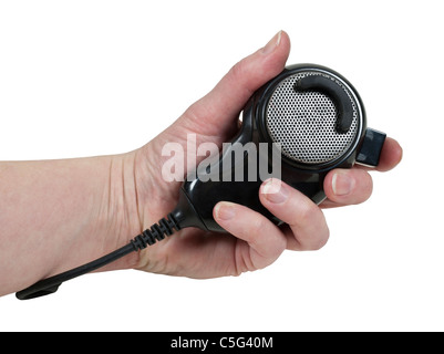 Holding a handheld microphone used to communicate via citizen band radio - path included - Stock Photo