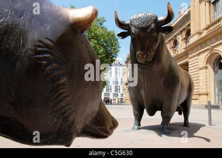 Bull and bear statues outside Frankfurt Stock Exchange, Germany - Stock Photo
