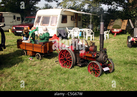 Children playing on miniature Foster traction engine built 1994 and seen at the 2006 YesterYear Rally Malpas Cheshire - Stock Photo