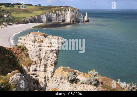 Falaise d'Aval or arch and the Aiguille or needle at Etretat in Normandy, France - Stock Photo