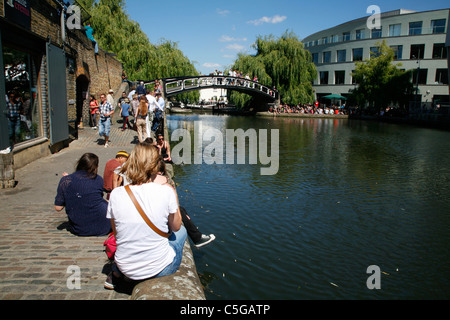 Crowds enjoying fine Summer sunshine on the banks of Regents Canal at Camden Town, London, UK - Stock Photo