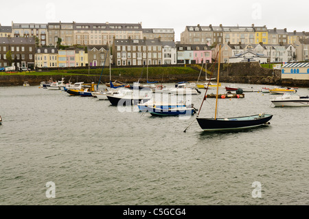 Boats in Portrush harbour on an overcast cloudy day - Stock Photo