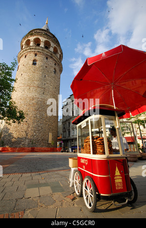 ISTANBUL, TURKEY. A cart selling simits (sesame-covered bread rings) by the Galata Tower in Beyoglu district. 2011. - Stock Photo