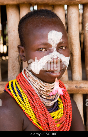 Portrait of a Karo tribes-girl at the of village Kolcho, in the Lower Omo Valley, Southern Ethiopia, Africa. - Stock Photo