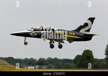 An Aero L39 Albatross jet training aircraft of the breitling jet team - Stock Photo