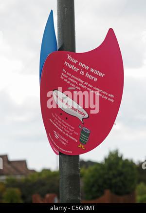 Water meter sign for households in street Littlehampton Sussex UK - Stock Photo