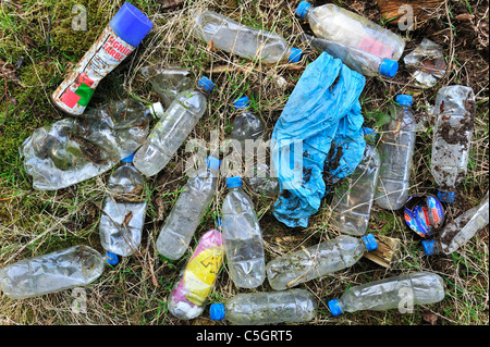 Discarded plastic bottles and other non-degradable rubbish in field, Belgium - Stock Photo