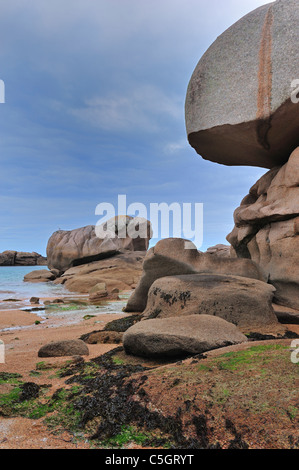 Rock formations along the Côte de granit rose / Pink Granite Coast at Trégastel, Côtes-d'Armor, Brittany, France - Stock Photo