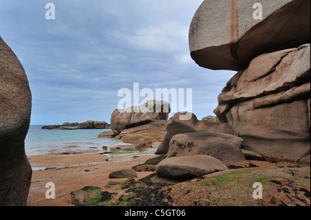 Rock formations along the Côte de granit rose / Pink Granite Coast at Trégastel, Brittany, France - Stock Photo