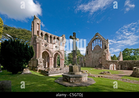 Dryburgh Abbey classic view with stone cross in foreground - Stock Photo