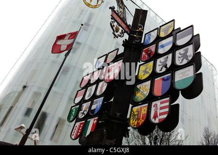 Cantonal tree with emblems of Swiss cantons in Leicester Square in London - Stock Photo