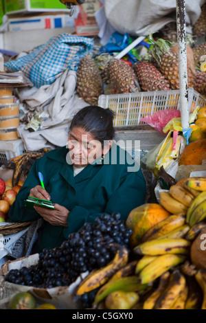 South America, fruit and vegetables vendor in market, Cuzco, Titicaca Lake, Machu Picchu Altiplano Andes Peru - Stock Photo