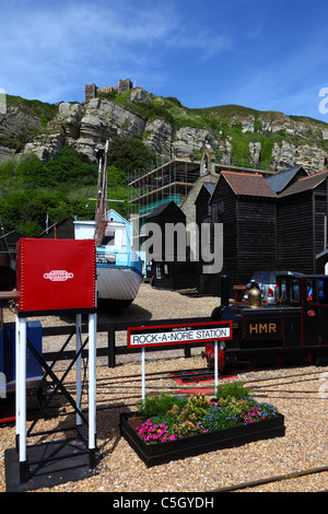 Rock-a-Nore station on Hastings Miniature Railway, Net Shops and East Hill lift in background, Hastings, East Sussex, - Stock Photo