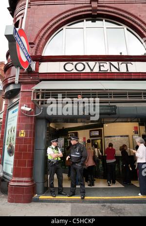 British police on patrol at Covent garden underground station, London UK - Stock Photo