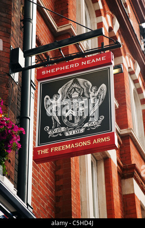 The sign for the Shepherd Neame pub, the Freemasons Arms, Covent Garden, London UK - Stock Photo