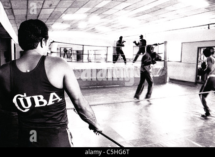 Cuba. Boxers and coach at an Olympic boxing training gym in Havana - Stock Photo